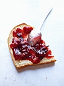 A slice of bread topped with damson jam