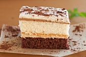 A slice of chocolate and vanilla layer cake