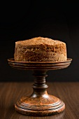 Carrot cake on a brown cake stand