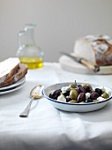 A bowl of olives with feta