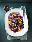 Red cabbage salad with beetroot and citrus fruits