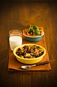 Bowl of Spiced Ground Beef with a Glass of Milk and a Side of Veggies