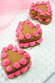 Heart-shaped sponge cakes decorated with pink cream