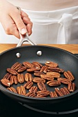 Pecan nuts being toasted