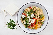 Rice pasta with vegetables and feta cheese