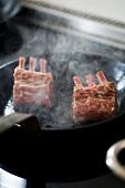 Lamb chops in a pan