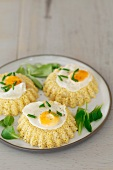 Millet cake with fried quail's eggs