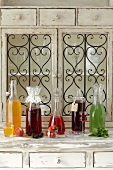 Various types of homemade liqueur: apricot, blackberry, strawberry, chokeberry and mint