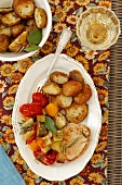 Pork escalope with oven-roasted vegetables and roasted potatoes