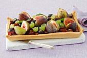 A plum, grape and fig tart