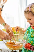 Little Girl Helping to Whisk Batter
