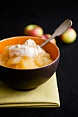Bowl of Cooked Apples with Whipped Cream
