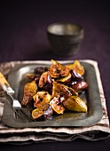 Sauteed Figs on a Metal Tray with a Serving Fork