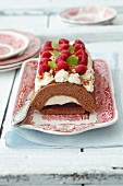 Chocolate Swiss roll with raspberry jam and cream