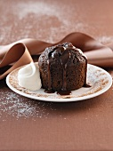 A chocolate cake with chocolate sauce and whipped cream