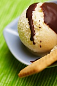 Pear ice cream with a biscuit and chocolate sauce