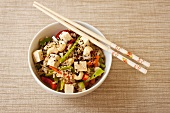 Asian Rice with Vegetables, Tofu, Sesame Seeds and Cashews; Chopsticks