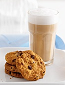 Chocolate chip cookies and a caffe latte