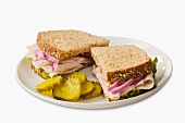 Turkey Sandwich on Wheat Bread; Halved with Pickles