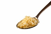 Spoonful of Chicken Noodle Soup on a White Background