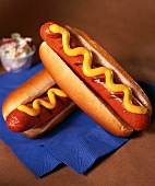 Two Grilled Hot Dogs with Mustard