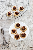 Piped pastries with hazelnuts