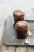 Mini cakes in glasses dusted with icing sugar