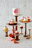 A Cake and Cupcakes on Assorted Stands