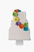 White Tiered Cake with Colorful Floral Decoration; White Background
