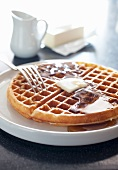 Buttermilk Waffle with Butter and Maple Syrup; Fork