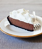 Slice of Chocolate Pudding Pie with Whipped Cream Topping