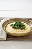 Bowl of Polenta Topped with Broccoli Rabe and Pine Nuts