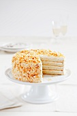 Layered Coconut Cake with a Slice Removed