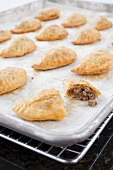 Beef and Cheese Empanadas on a Baking Sheet
