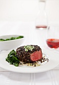Pepper Crusted Filet Mignon with Wilted Greens