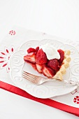 Slice of Fresh Strawberry Pie with Whipped Cream on a White Plate with a Fork