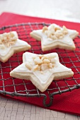 Three Macadamia Eggnog Cream Star Cookies on a Cooling Rack