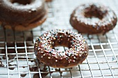 Glazed Doughnut with Colored Sprinkles on a Cooling Rack