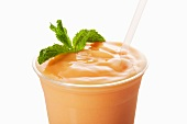 Mango Shake in a Plastic Cup with a Straw; White Background