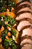 Sliced Pork with Broccoli Rabe and Nuts