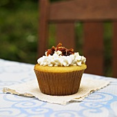 Vanilla Cupcake with Maple Frosting and Bacon Pieces