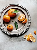 Clementines on a Pewter Plate