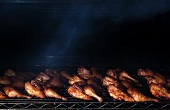 Half Chickens Cooking in a Smoker