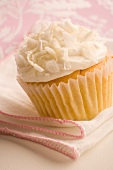 Vanilla Cupcake with Vanilla Frosting and Shaved Coconut