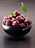 Fresh cherries in a black bowl