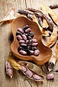 Borlotti beans in a wooden bowl