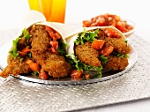 Breaded chicken fillets and tomato salsa wraps
