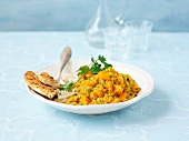 Vegetable curry with rice and unleavened bread