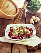 Trout fillets with chopped egg and eggs sauce on a bed of radicchio