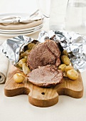 Roast beef with balsamic vinegar and potatoes in foil